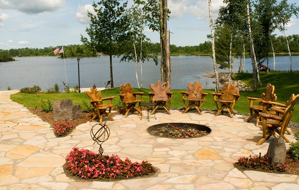 firepit and patio near lake